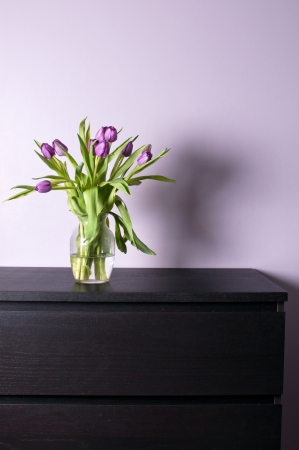 Modern interior chest drawer decorated with flowers photo