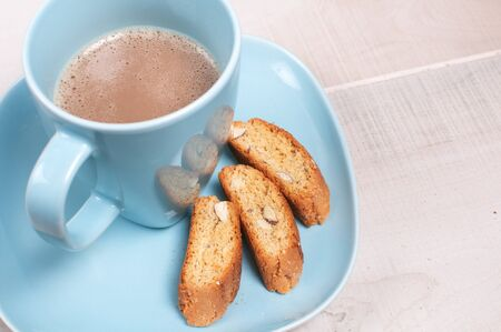 almond biscuit: Coffee with milk and almond biscuit cookies horizontal Stock Photo
