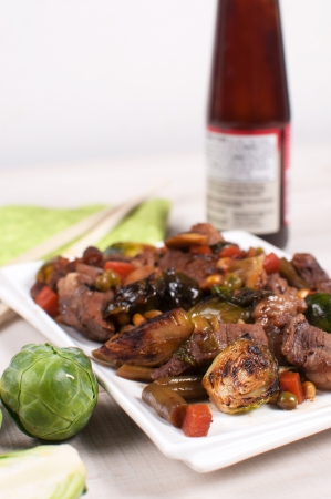 Stir fry meat and vegetables with sauce vertical photo