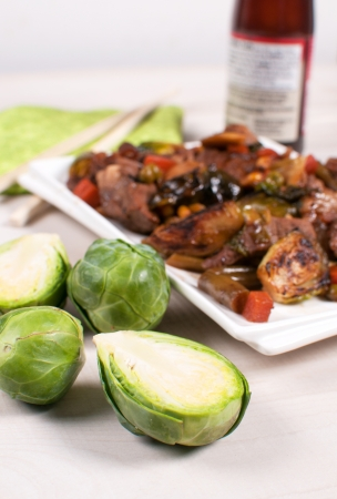 Grilled brussels sprouts with meat and sauce vertical photo