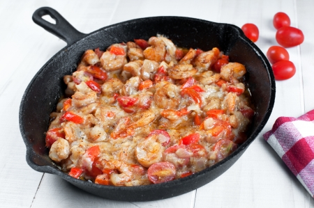sautee: Cooking shrimp and cherry tomatoes in cast iron skillet
