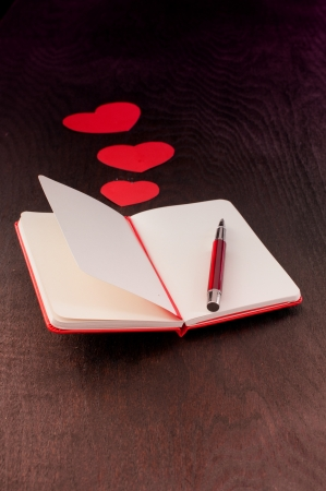 Writing about love in red notebook photo