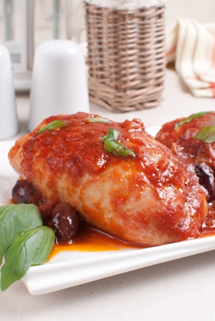 Braised chicken with tomato sauce and kalamata olives photo