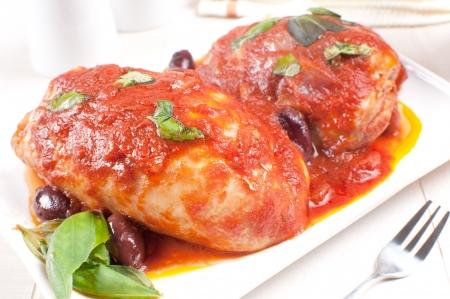kalamata: Chicken braised with basil, tomato sauce and kalamata olives Stock Photo