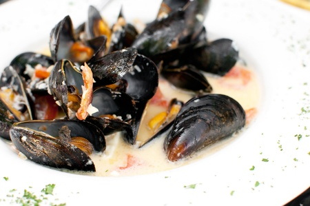 Ocean mussels dish cooked with garlic Stock Photo