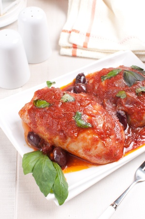 Braised chicken thighs with tomato olive sauce photo