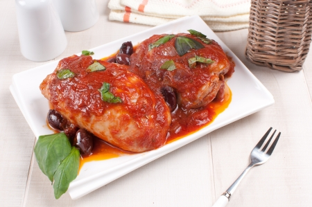 eating chicken: Tomato sauce braised chicken with olives and basil Stock Photo