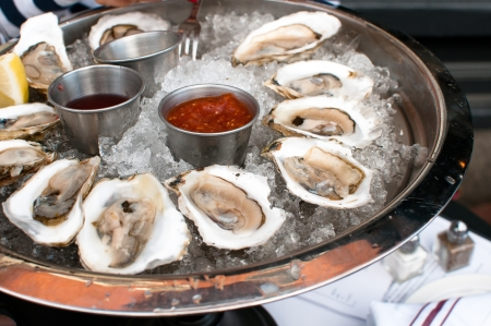 shucked: Oysters served raw with sauces and lemon
