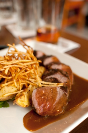 frites: Cut beef steak frites with sauce vertical