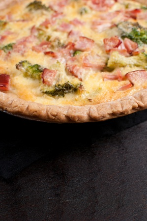 Quiche with ham, cheese and broccoli with copy space photo