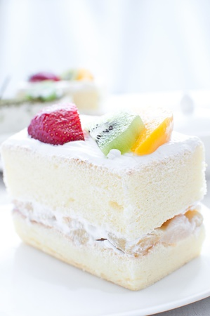 Shortcake with cream and fruits piece photo