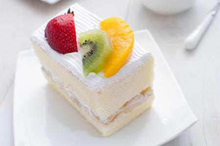 Strawberry, kiwi and mango light fruit cake photo