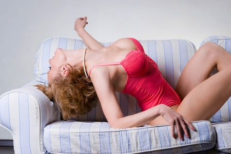 A sexy young woman on the sofa