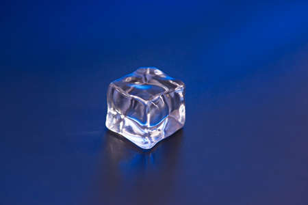 icecube: An ice cube on the blue background Stock Photo