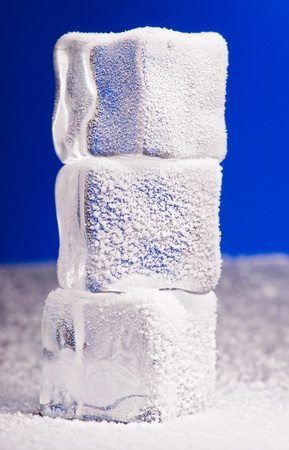 Three clear ice cubes covered with hoarfrost Stock Photo - 12900421