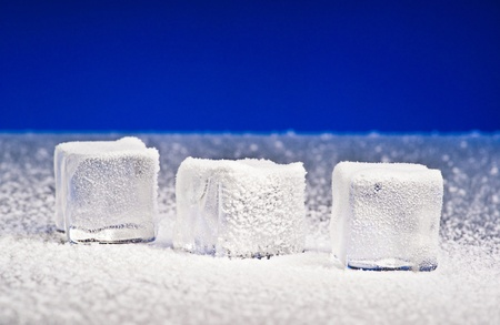 Three clear ice cubes covered with hoarfrost Stock Photo