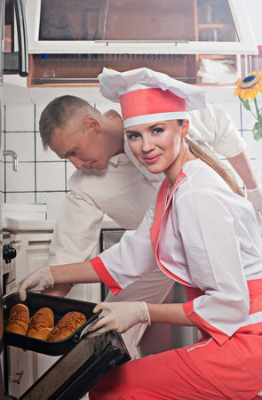 Couple in the kitchen. Cooking at home. photo