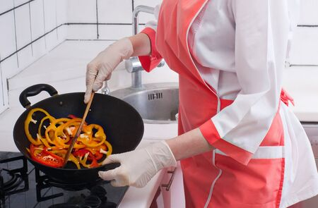 Beautiful girl in the kitchen. Cooking at home. photo