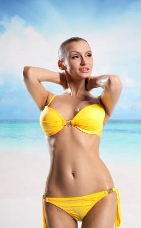 Young beautiful woman enjoying the sun on the beach