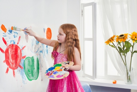 Beautiful little girl playing with bright watercolour Stock Photo - 13507419