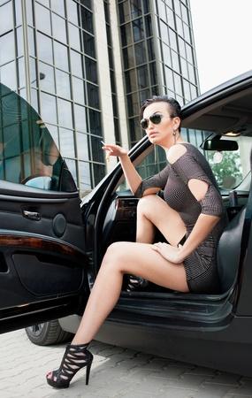 Modern stylish woman in city photo