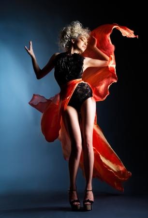 Beautiful girl in red dress photo