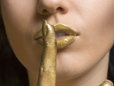 Gold lips of a girl Stock Photo - 13963263