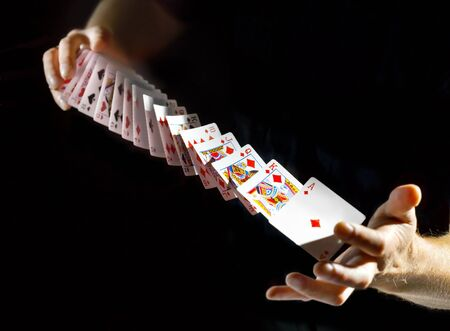 Deck of cards in the hands photo