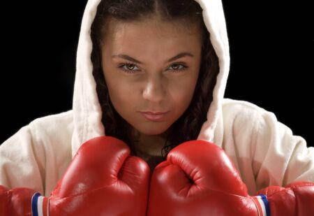 red bathrobe: Shot of a beautiful girl boxer