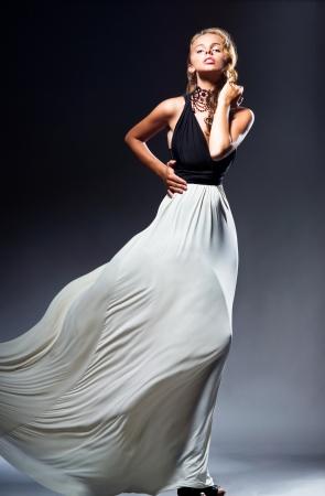 Alluring girl in flowing skirt