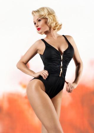 Slim blonde in black swimsuit  photo