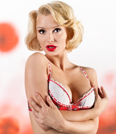 Portrait of blonde in red lingerie photo