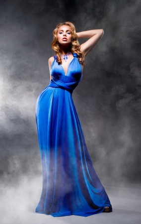 Beautiful girl in blue evening dress photo
