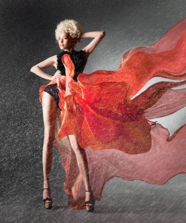 Snowbound girl in fluttering red skirt
