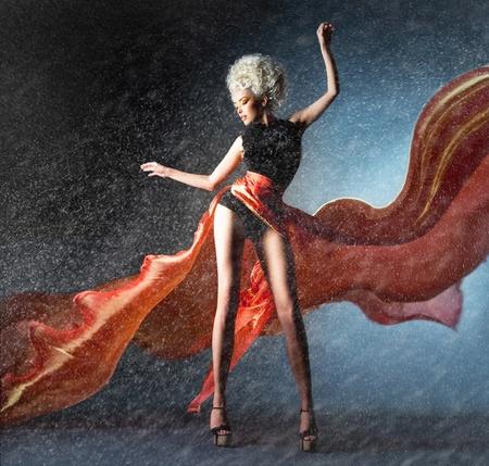 Snowbound dancer in fluttering red skirt photo