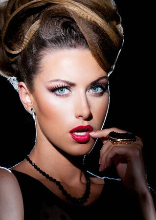Beautiful woman in evening makeup and hairstyle Stock Photo - 14961780