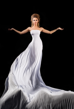 Flying girl in long white dress photo