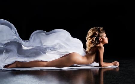 Beautiful sexual girl lies on silk  Stock Photo