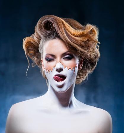 Ongebruikelijke make-up van mooi meisje Stockfoto