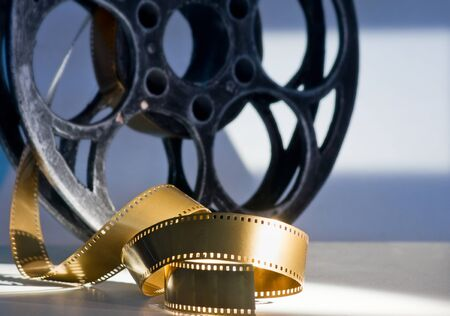 Golden film on the background of reel photo