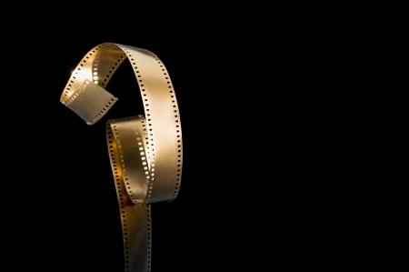 epoch: Torta pellicola d'oro su sfondo nero