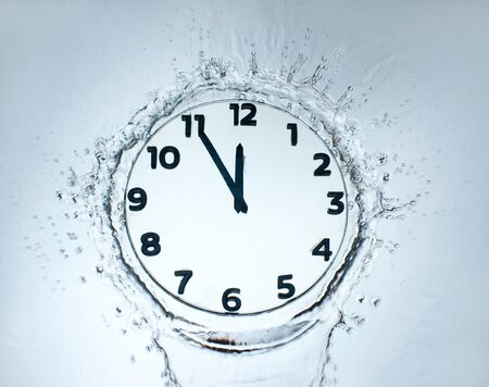 Unusual design clock with water photo
