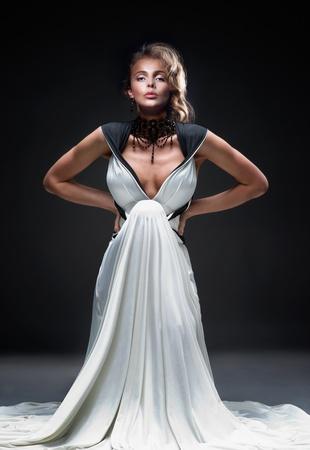 Luxury blonde in white evening dress Stock Photo - 16334312