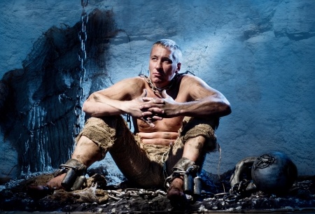 Prisoner in heavy shackles and chains Stock Photo - 16348676