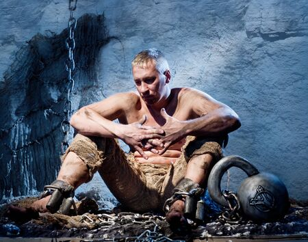 Prisoner in heavy shackles and chains Stock Photo - 16348675