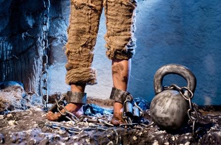 culprit: Legs in heavy iron shackles