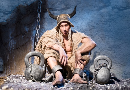 Captive soldier in shackles and tattered clothing Stock Photo - 16410040