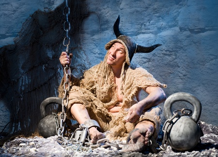 Captive soldier in shackles and tattered clothing Stock Photo - 16410038