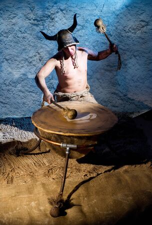 paganism: Mad shaman with ritual drum Stock Photo