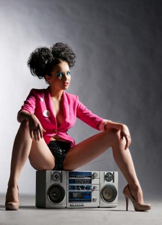 Disco meisje met een bandrecorder Stockfoto